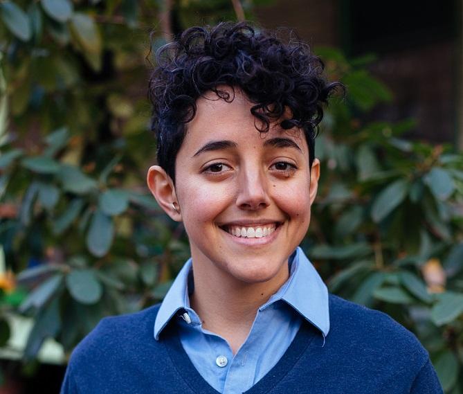 Dr. Blum, a gender-nonconforming white woman smiling.